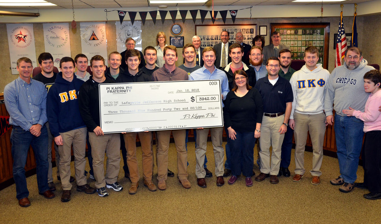 Brothers Pose with check to present to Lafayette Jeff