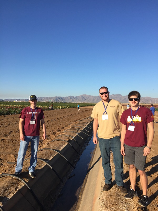 Brothers Blain Knutson, Kevin Lapham, and Sam Birkholz at a rose bush farm in Phoenix, Arizona on a tour at SASES