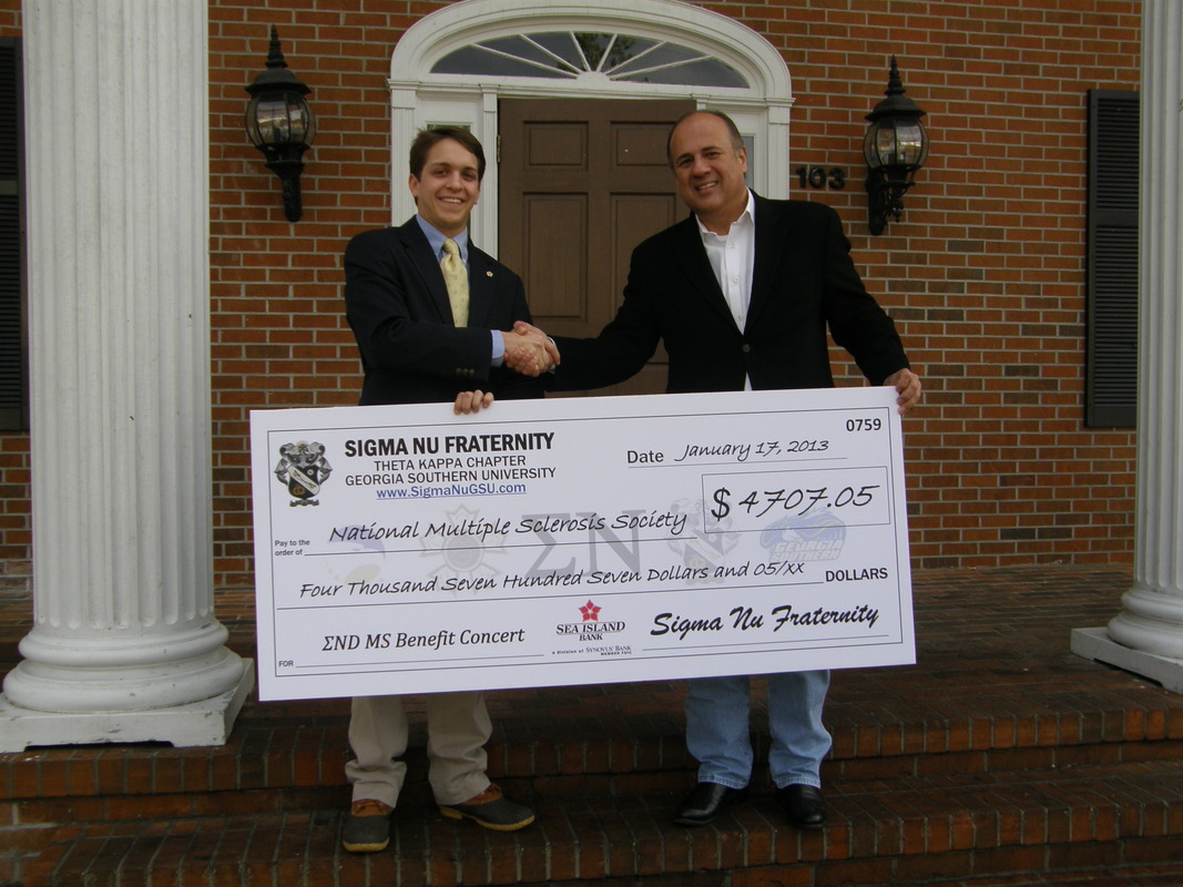 Brian Griffin presents check to Chuck Rangel, National MS Society