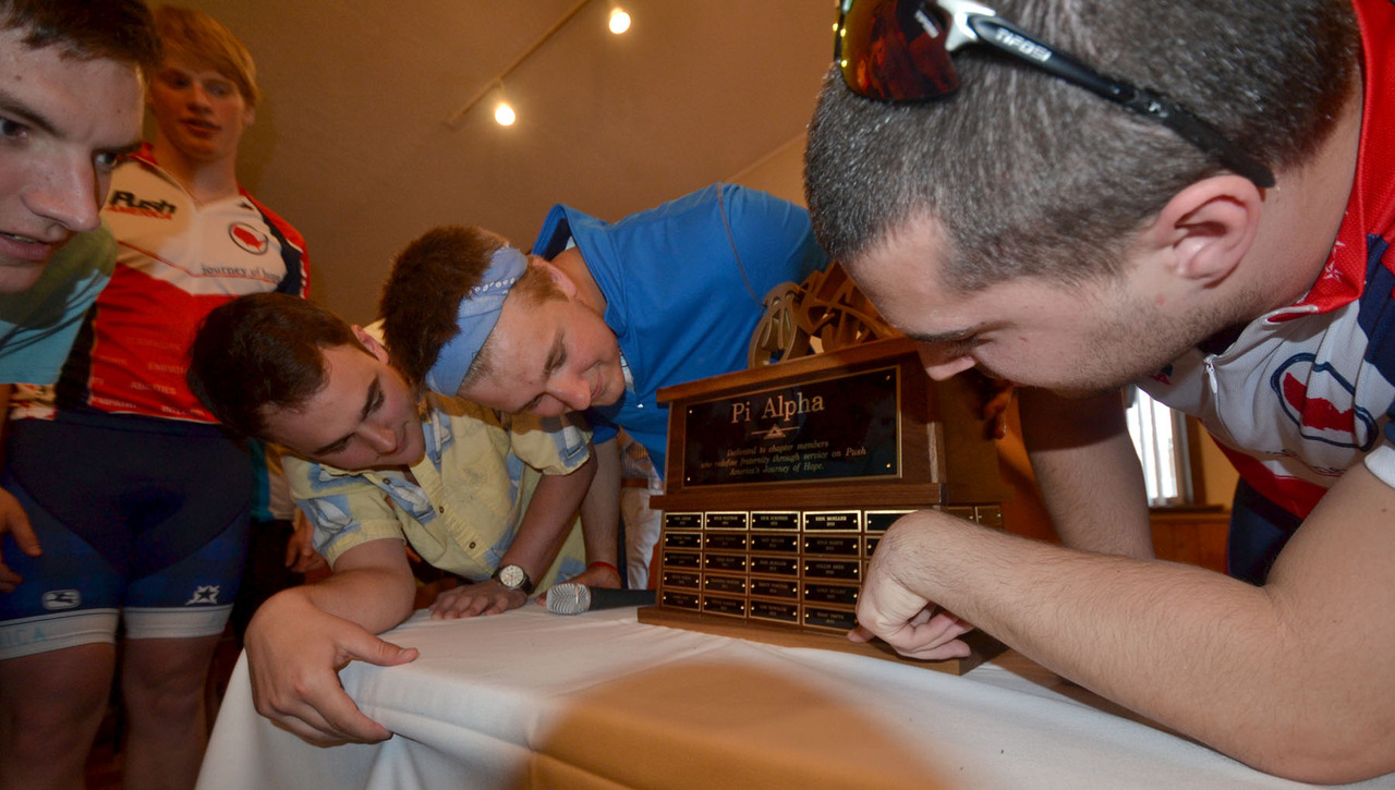 098-2014_moms_day-pi_alpha_trophy_looking_at_it.jpg