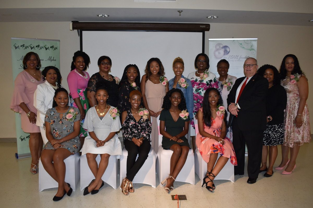 Image of Rho Zeta Omega scholarship recipients seated among chapter members