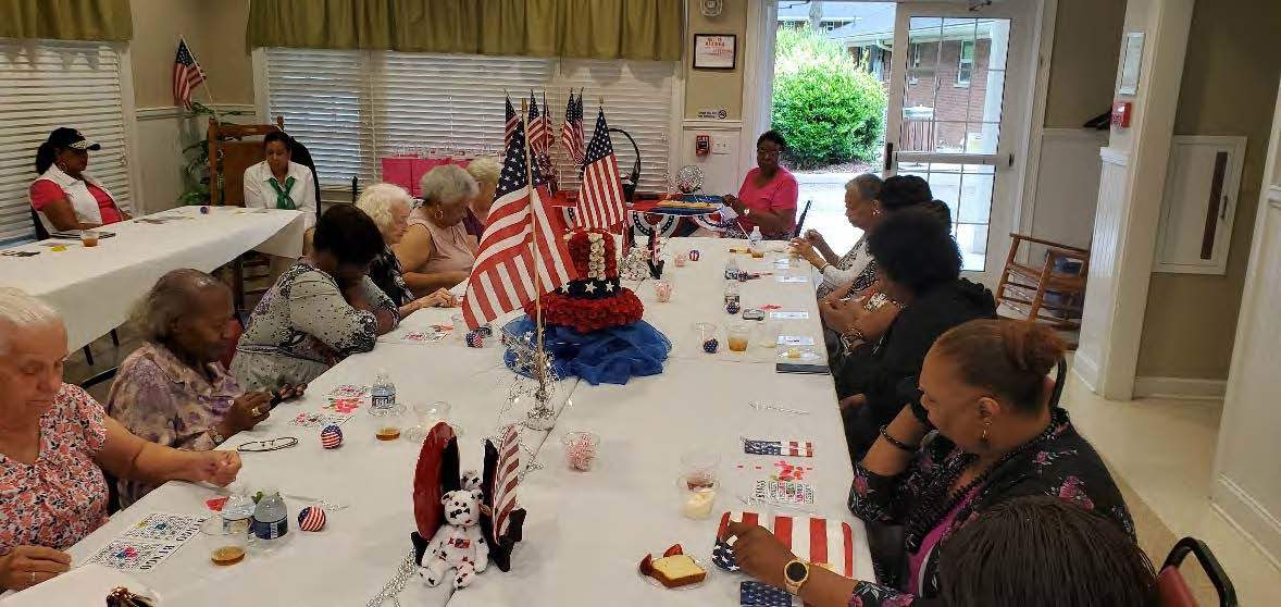 September_2019_senior_citizens_with_American_flags_on_the_table.jpg